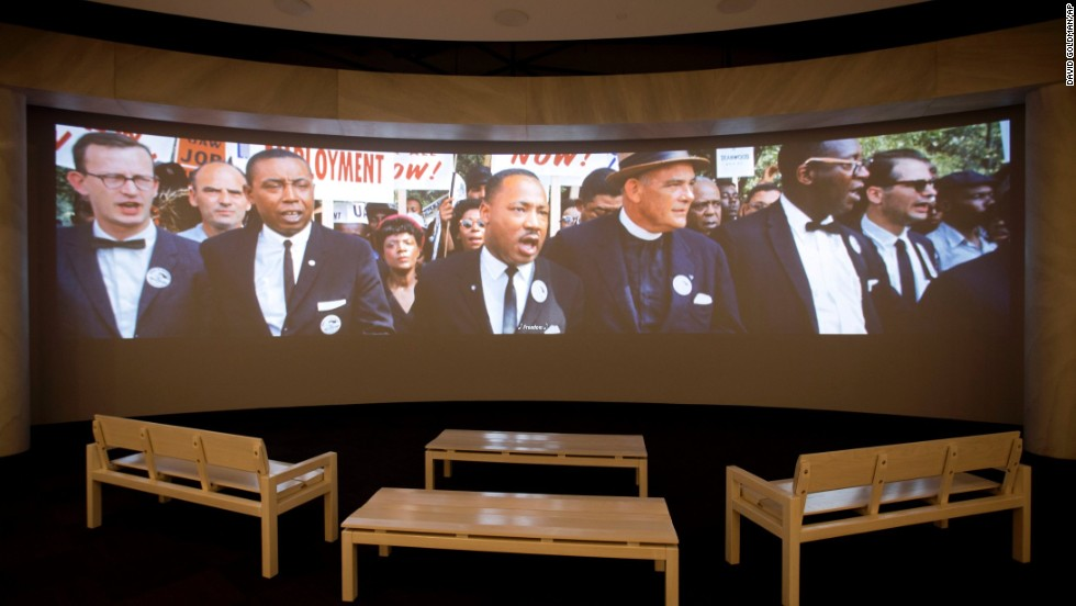 "A movie plays as part of the March on Washington exhibit. <a href=""http://www.cnn.com/2013/08/23/us/gallery/color-march-on-washington/index.html"">See more photos from the 1963 rally</a>, where the Rev. Martin Luther King Jr. delivered his historic ""I Have a Dream"" speech."