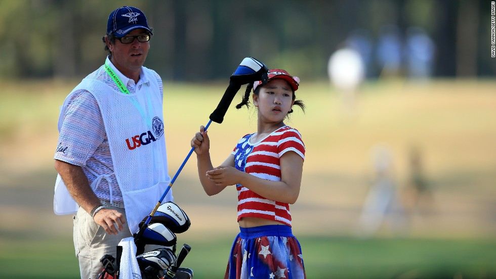 The 11-year-old suffered setbacks with two double-bogeys and a triple-bogey, but looked assured.