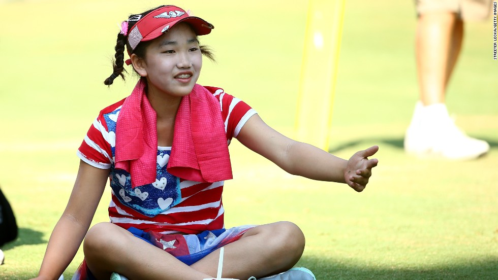 World No. 1 Stacy Lewis questioned the wisdom of allowing an 11-year-old to play in the high-pressure tournament, but Li responded with a relaxed round that included two birdies.
