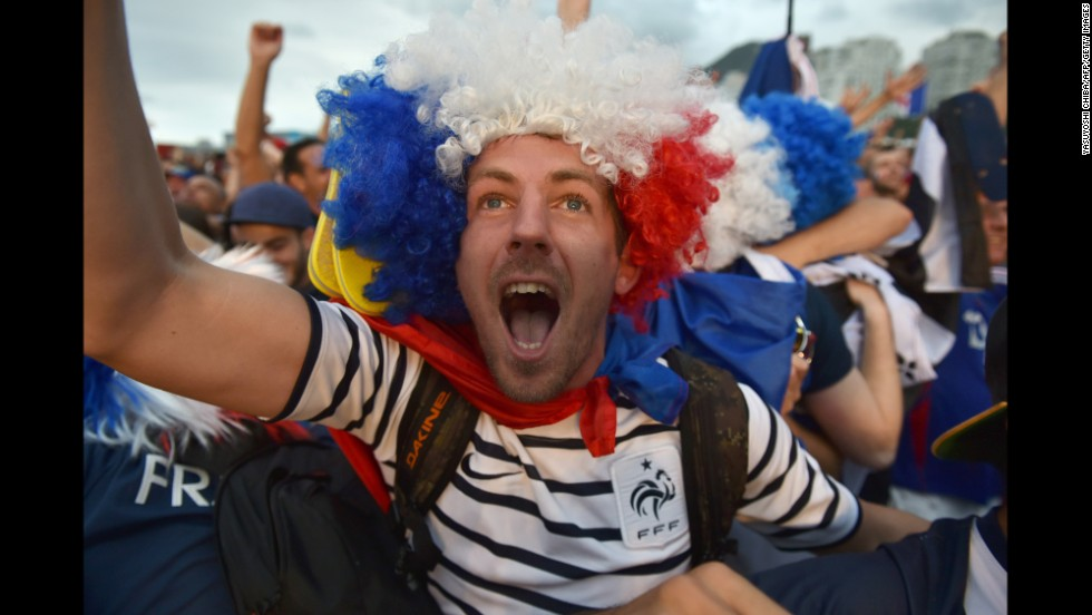 France supporters cheer during the match.