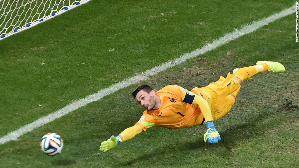 France's goalkeeper, Hugo Lloris, can't reach a free kick from Switzerland's Blerim Dzemaili.