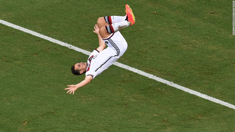 Miroslav Klose of Germany does a flip in celebration of scoring his team's second goal. It gave Klose his 15th goal in the World Cup, drawing him level with Brazilian great Ronaldo for the scoring record.