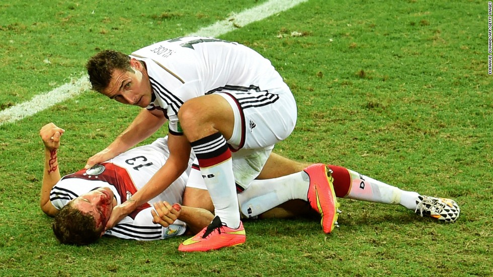 Germany forward Miroslav Klose, right, checks Germany forward Thomas Muller after a collision during a World Cup match against Ghana at Castelao Stadium in Fortaleza, Brazil. The game ended in a 2-2 draw.