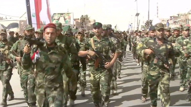Iraqi Shias show force in weapons parade