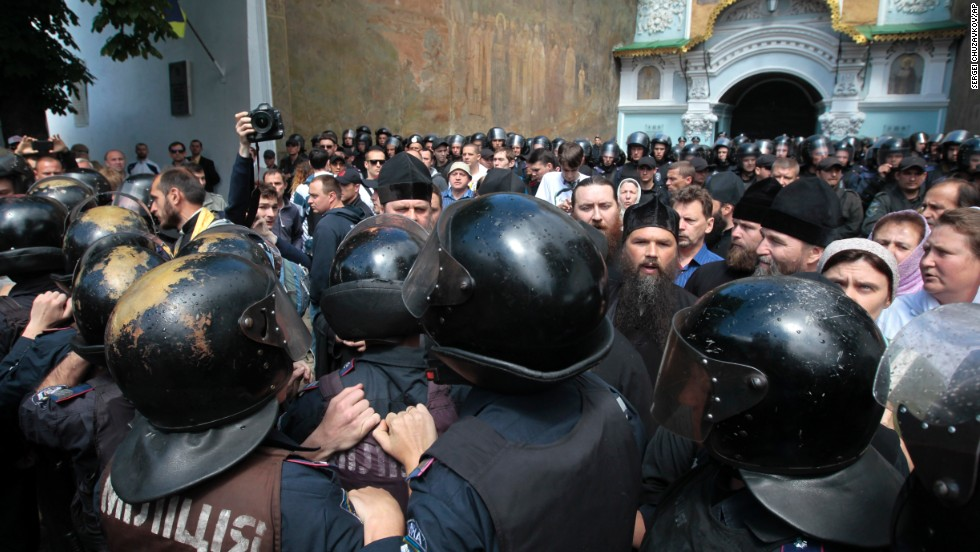 Riot police surround the Kiev Pechersk Lavra, an Orthodox Christian monastery in Kiev where radical masked activists gather to protest against separatists on June 22.
