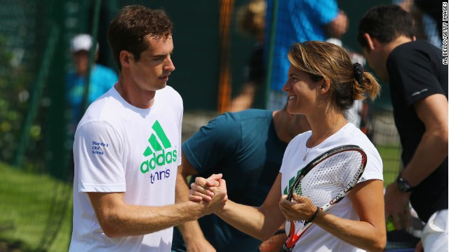 Andy Murray talks with coach Amelie Mauresmo during a practice session for the Wimbledon Championships.