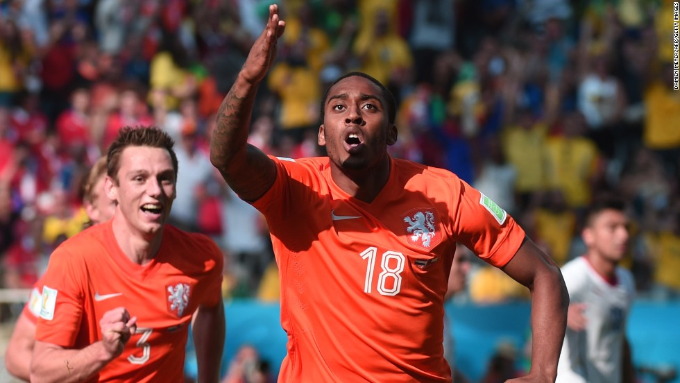 Netherlands midfielder Leroy Fer, right, celebrates scoring with his teammates.