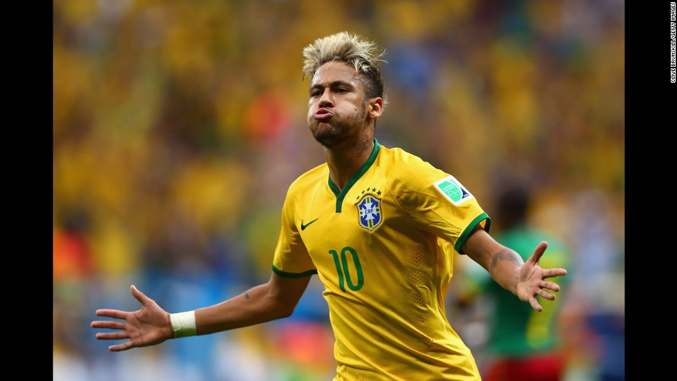 Neymar of Brazil celebrates scoring his second goal of the game.