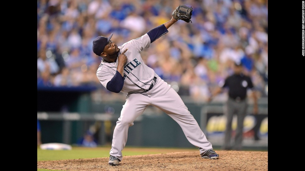 Seattle Mariners relief pitcher Fernando Rodney celebrates a 7-5 win against the Kansas City Royals after striking out Alex Gordon to end the ninth inning on Friday, June 20, in Kansas City, Missouri.