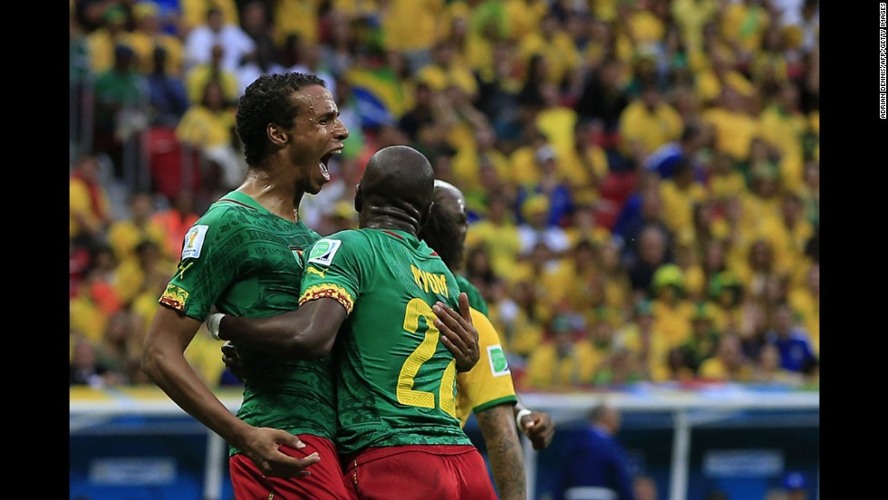 Cameroon midfielder Joel Matip, left, celebrates with his teammates after scoring a goal against Brazil.