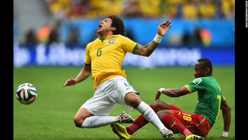 Brazil's Marcelo, left, is challenged by Enoh Eyong of Cameroon.