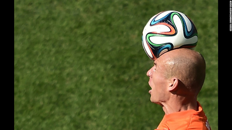 "Netherlands forward Arjen Robben heads the ball during <a href=""http://www.cnn.com/2014/06/23/sport/football/netherlands-chile-spain-australia/index.html"">a World Cup match</a> against Chile on Monday, June 23, in Sao Paulo. Netherlands won 2-0."