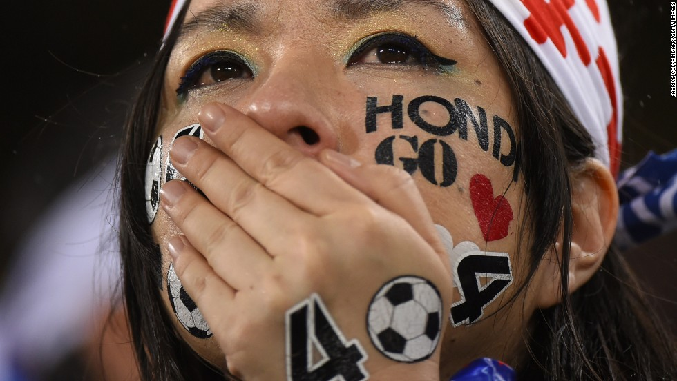 A Japan supporter cries after her team tied Greece in group play on June 19.