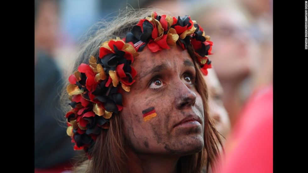 A fan of Germany watches from Berlin as Germany plays Ghana on June 21. The match ended 2-2.