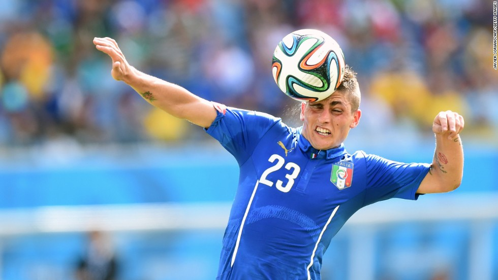 Midfielder Marco Verratti of Italy heads the ball.