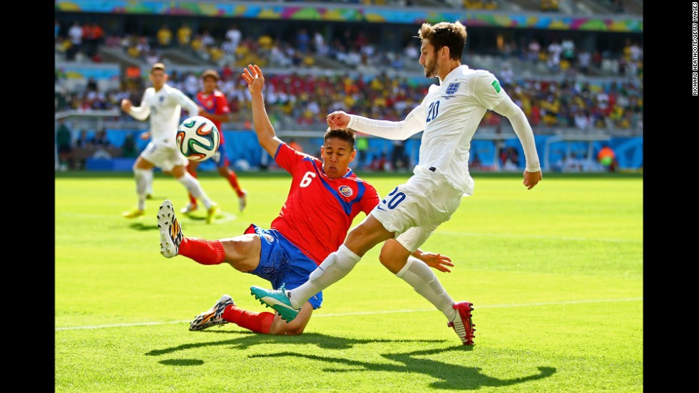 Adam Lallana of England is challenged by Oscar Duarte of Costa Rica during a match at Estadio Mineirao in Belo Horizonte. The game ended in a 0-0 draw.