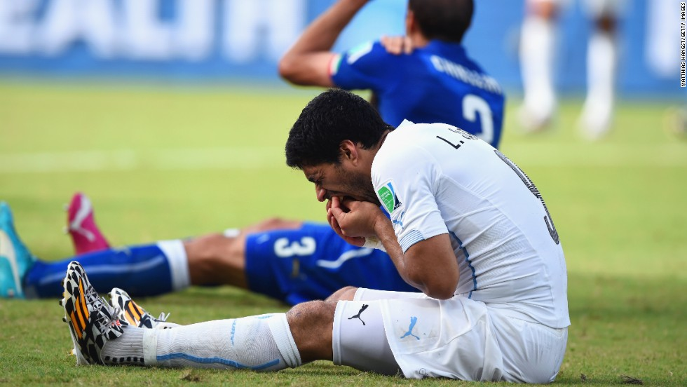 Luis Suarez and Italy's Giorgio Chiellini are pictured seconds after the 2014 World Cup biting incident.