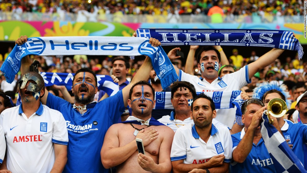 Greece fans cheer during the game against the Ivory Coast.