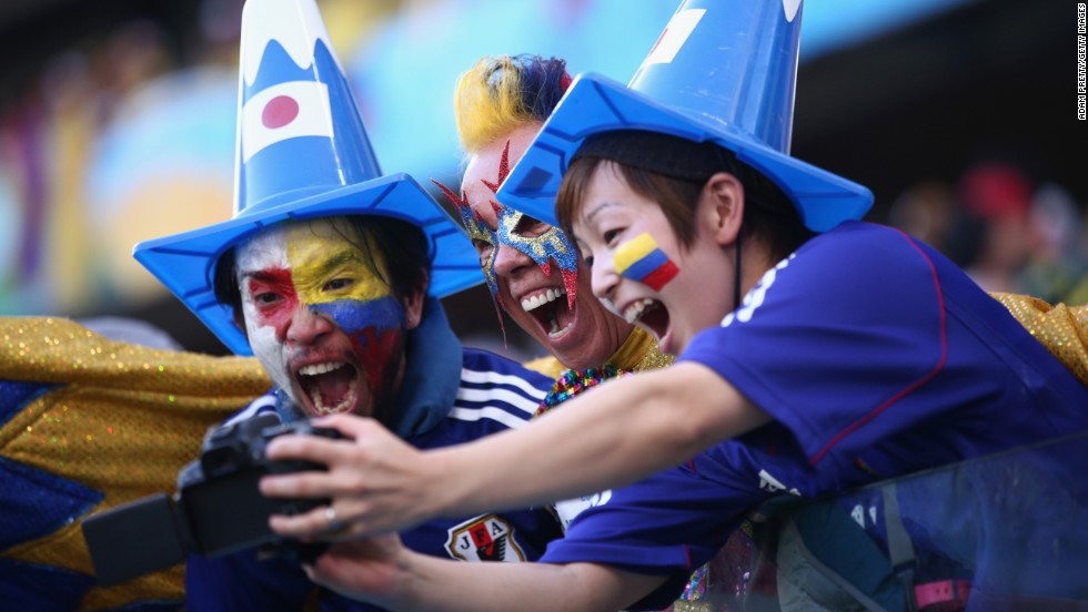 Colombia and Japan fans pose together for a selfie.
