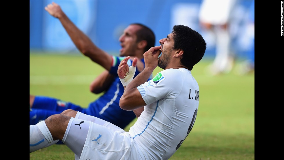 Suarez holds his mouth as Chiellini sits in the background. Suarez will now face a nervous wait to find out if football's world governing body FIFA will take action retrospectively -- given it was missed by the match officials -- and punish him.