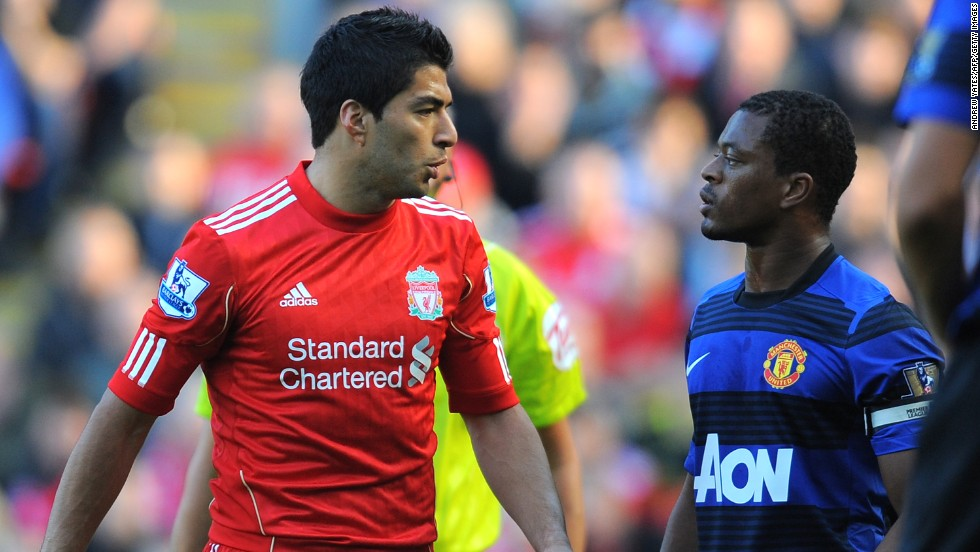 After his move to Liverpool in 2011, Suarez, left, was found guilty of racially abusing Manchester United's Patrice Evra and was fined $63,000 and banned for eight matches.