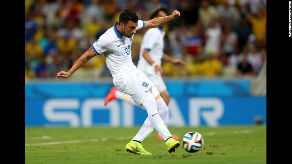 Andreas Samaris of Greece scores against the Ivory Coast.