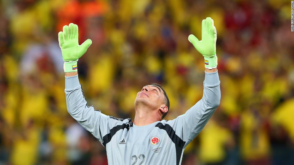 Goalkeeper Faryd Mondragon of Colombia acknowledges fans after his team defeated Japan 4-1 during a match in Cuiaba, Brazil.