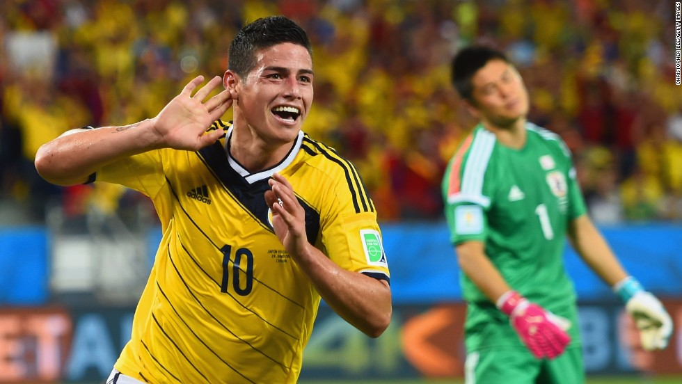 Colombia's James Rodriguez celebrates after scoring his team's fourth goal past goalkeeper Eiji Kawashima of Japan.