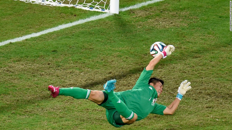 Japan's goalkeeper Eiji Kawashima fails to stop Colombia from scoring.