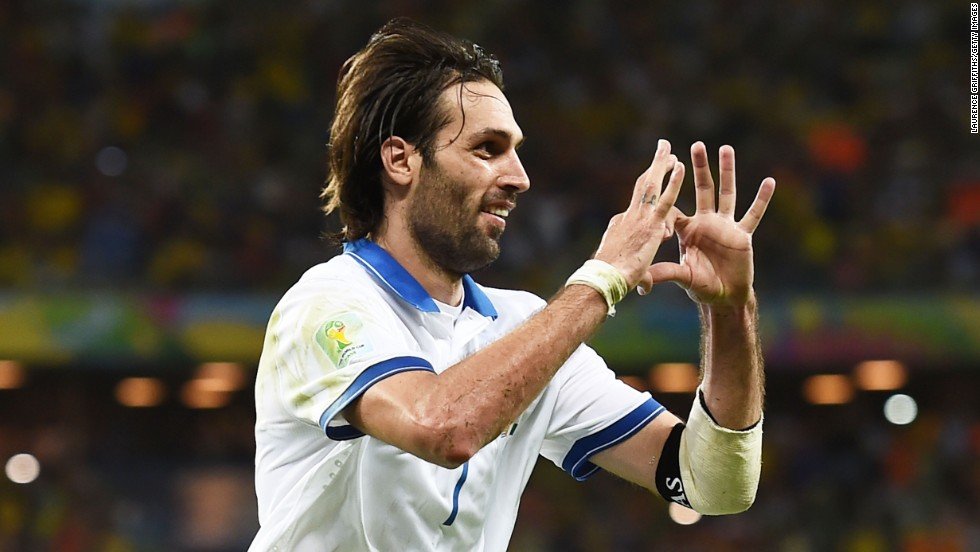 Giorgos Samaras of Greece celebrates scoring his team's second goal on a penalty kick against the Ivory Coast on Tuesday, June 24, in Fortaleza, Brazil. Greece won 2-1.