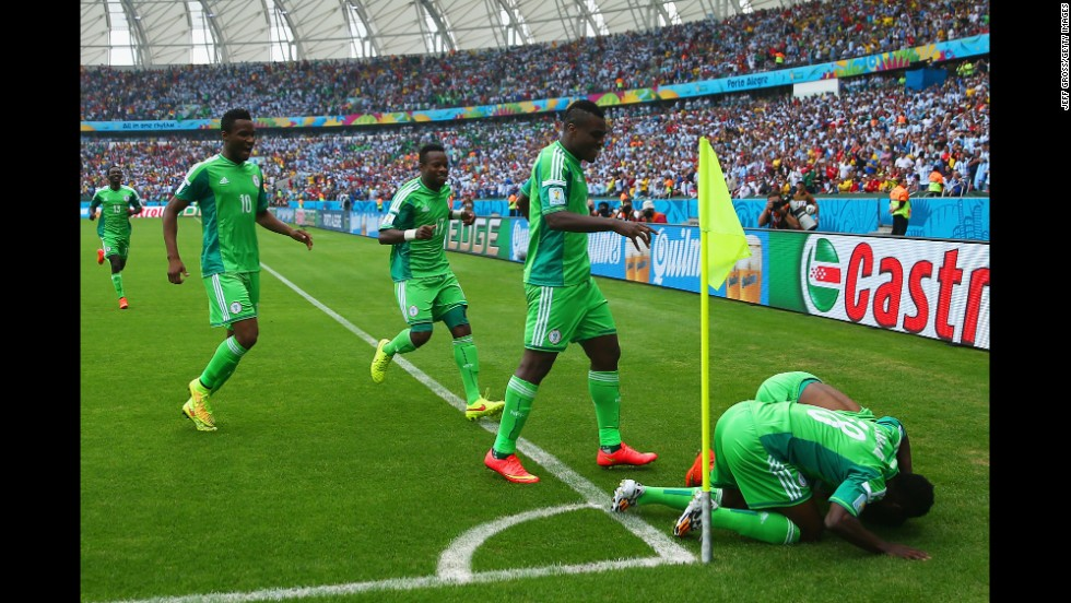 Ahmed Musa of Nigeria celebrates scoring his team's first goal with teammates during a match between Nigeria and Argentina at Estadio Beira-Rio in Porto Alegre, Brazil.