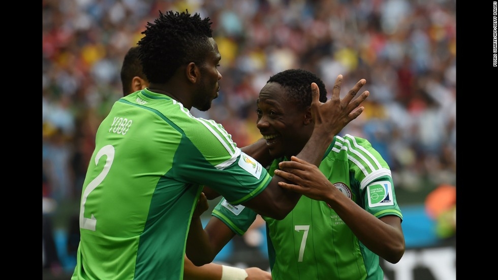 Musa, right, celebrates his goal with Nigeria defender Joseph Yobo during a match against Argentina.