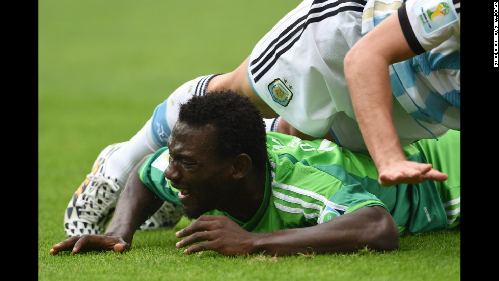 Nigeria midfielder John Obi Mikel falls during a match between Nigeria and Argentina.