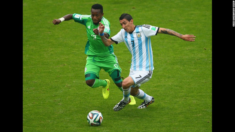 Ogenyi Onazi of Nigeria challenges Angel di Maria of Argentina.