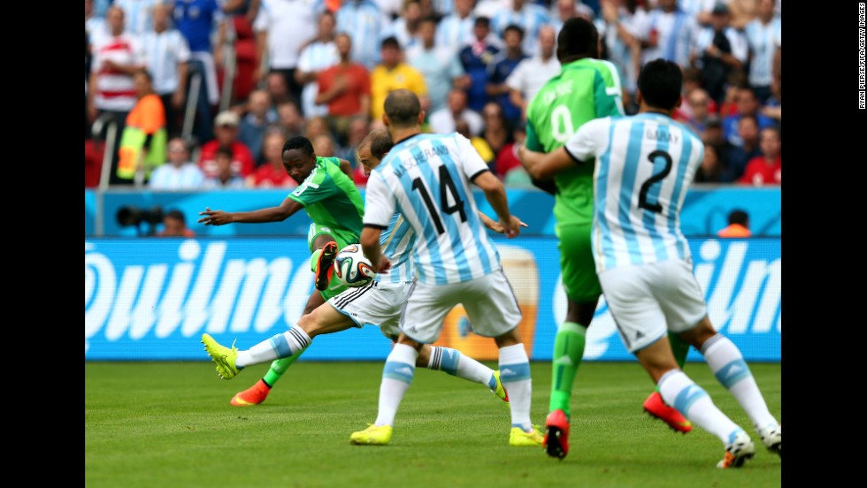 Ahmed Musa, far left, of Nigeria scores his team's first goal.