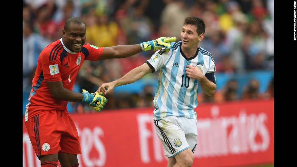 Argentina's forward Lionel Messi, right, and Nigeria's goalkeeper Vincent Enyeama smile during the game.