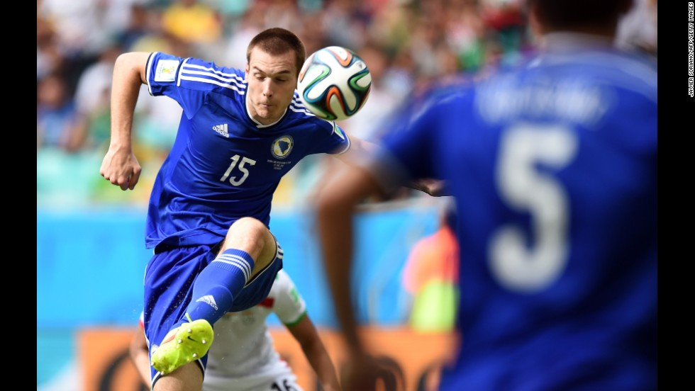 Bosnia-Herzegovina's defender Toni Sunjic, left, in action during a match against Iran at Arena Fonte Nova in Salvador, Brazil.