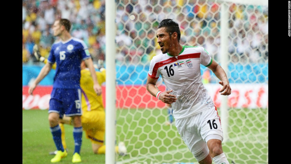 Reza Ghoochannejhad of Iran celebrates scoring his team's first goal.