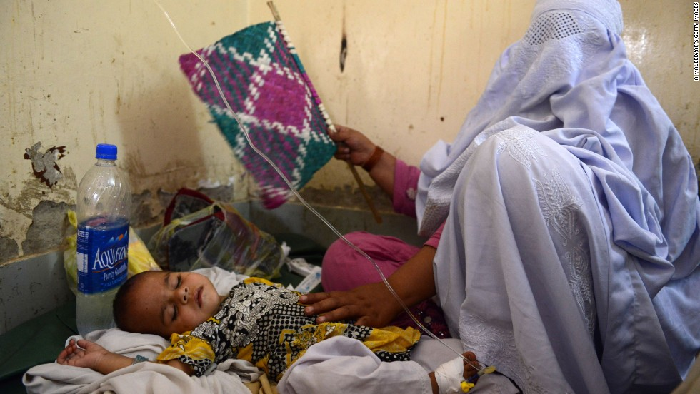 A displaced Pakistani woman takes care of her sick child at the Women and Children Hospital in Bannu on June 21.