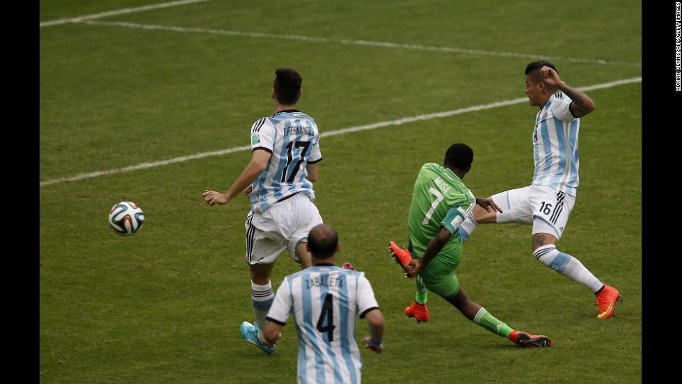Nigeria's forward Ahmed Musa scores his second goal past Argentina's defender Federico Fernandez, left, and Argentina's defender Marcos Rojo.