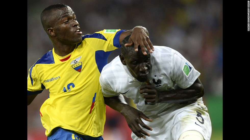 Ecuador forward Enner Valencia, left, and France defender Mamadou Sakho compete for the ball.
