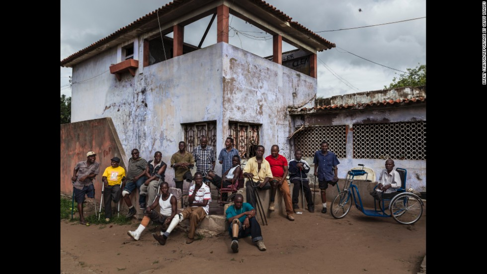 Former Mozambique Liberation Front soldiers are seen at their squatter housing in an abandoned building. Most of them are disabled as a result of land mine blasts. They receive a small pension every month from the government.