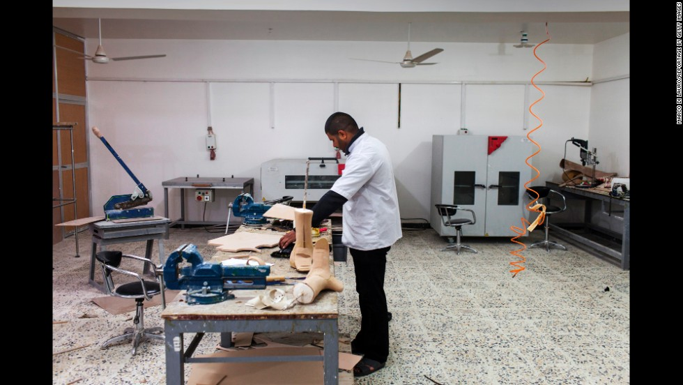 A technician manufactures prosthetics at the rehabilitation center in Najaf.