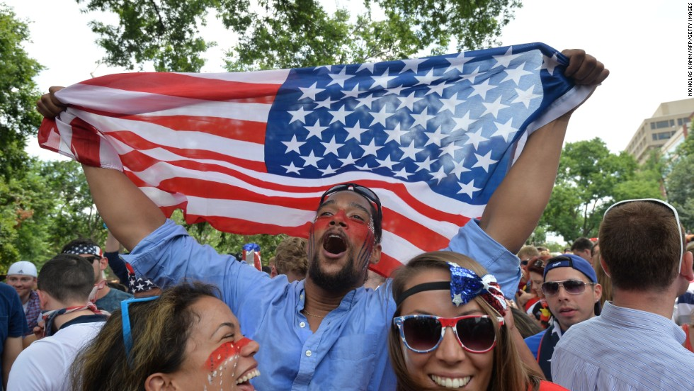 Fans celebrate from Dupont Circle in Washington on Thursday, June 26, after learning that the United States team, despite losing to Germany, advanced to the Round of 16 in the World Cup.