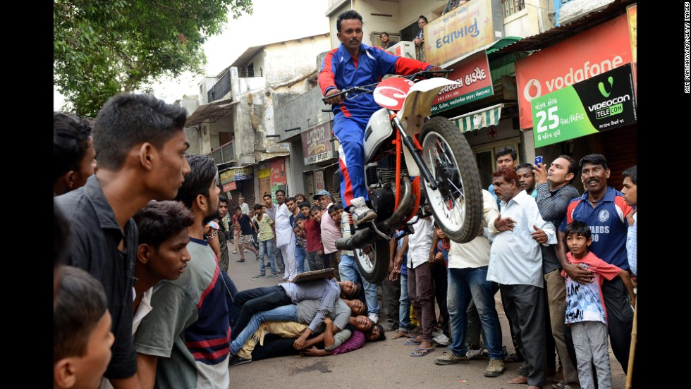 Motorcyclist Kalpesh Modi performs in the streets of Ahmedabad, India, on Sunday, June 22. He was rehearsing for the Lord Jagannath Rath Yatra festival, schedule for June 29.