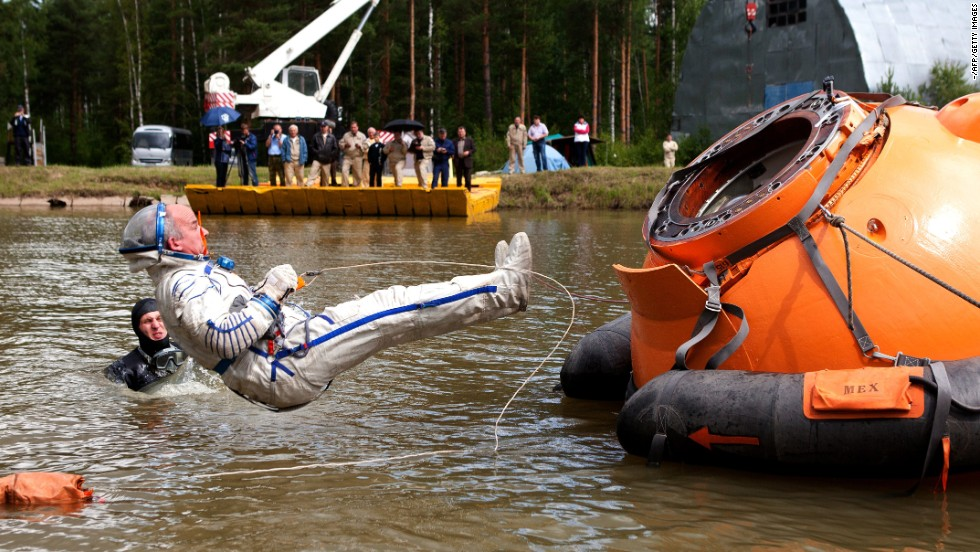 U.S. astronaut Jeffrey Williams takes part in a water landing simulation during his preflight training outside Moscow on Wednesday, June 25. He is scheduled to head to the International Space Station in 2016.
