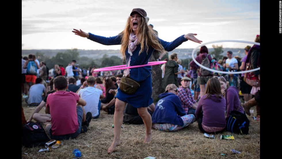 A reveler hula hoops ahead of the Glastonbury Festival on Worthy Farm in Somerset, England, on Wednesday, June 25.