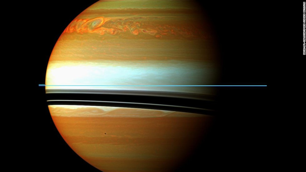 5. Studies of the great northern storm of 2010-2011.  In 2010 Cassini got a front-row seat to a massive storm that disrupted Saturn's relatively tranquil atmosphere. The largest temperature increases recorded for any planet were measured. Molecules never before seen in Saturn's upper atmosphere were detected. The storm diminished shortly after its head collided with its tail, a little less than a year after it began.  Saturn's rings are seen as the thin blue line in this image, due to the filters  used to show methane absorption.  The rings are outside the atmosphere, and therefore  are not affected by methane absorption.