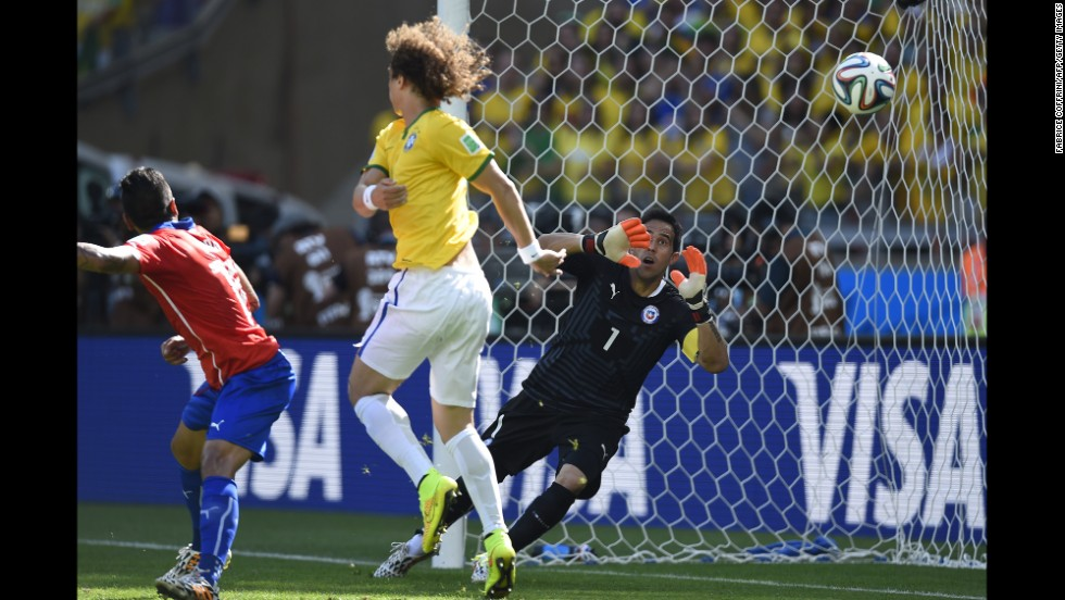 Chile's goalkeeper, Claudio Bravo, can't stop the ball from going in for a Brazil goal. The goal was initially awarded to David Luiz, center, but it was later determined to be an own goal by Chile's Gonzalo Jara.