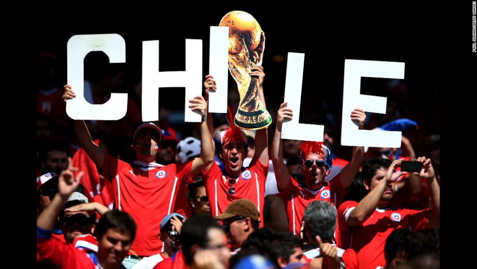 Chile supporters cheer together at Mineirao Stadium in Belo Horizonte, Brazil.